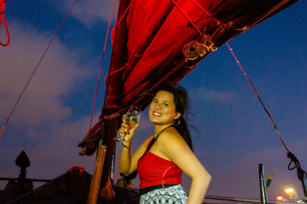 with a glass of wine in hand, off to sail the harbour