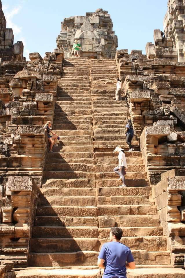 I first went to Cambodia in 2011. This is how it looked like then. We had to climb with all fours since the steps were tall, thin, slim. Now, they built a wooden staircase over it.